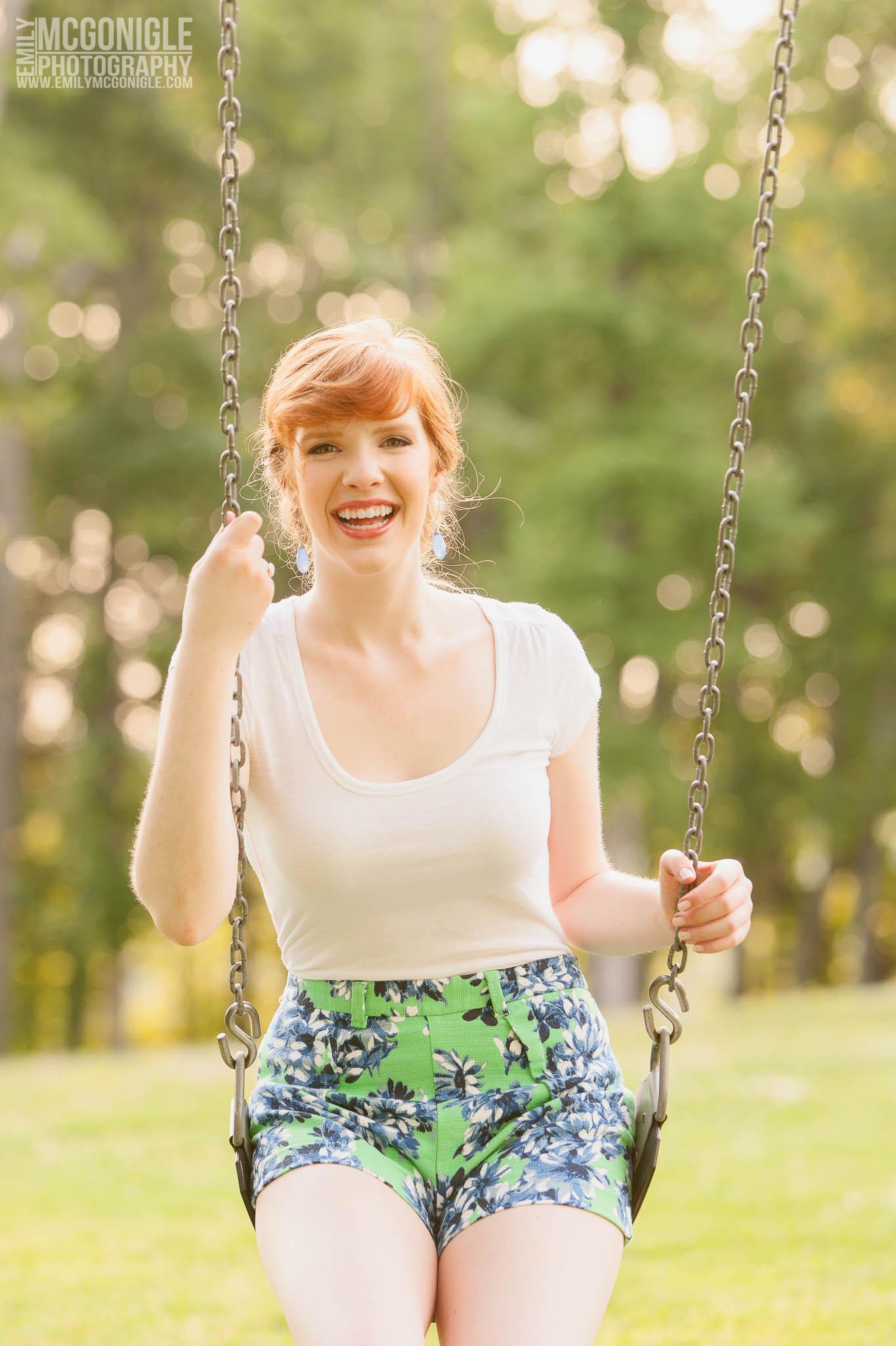 girl-swinging-smiling-shorts-redhead.jpg