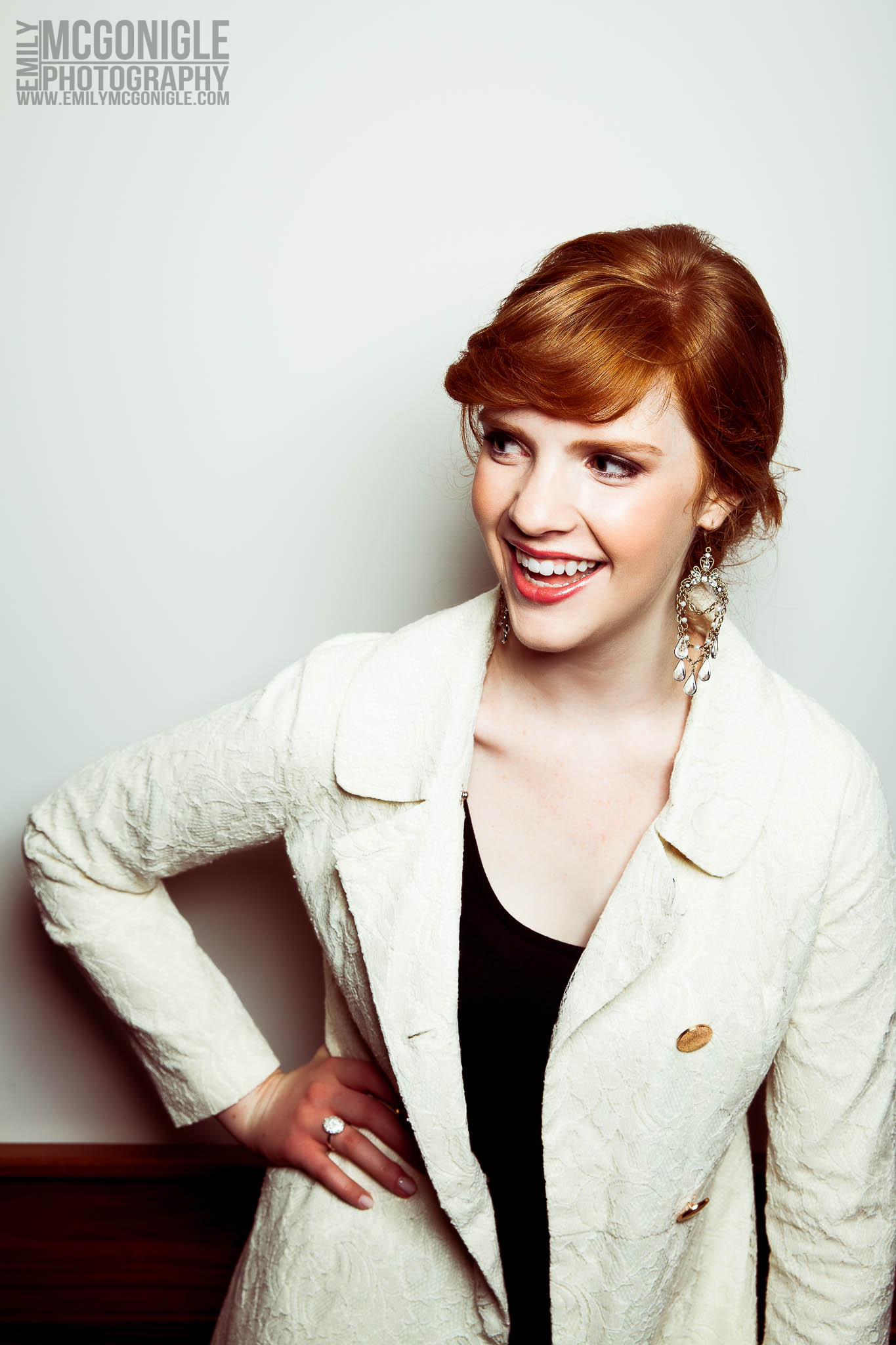 laughing-red-hair-white-wall.jpg