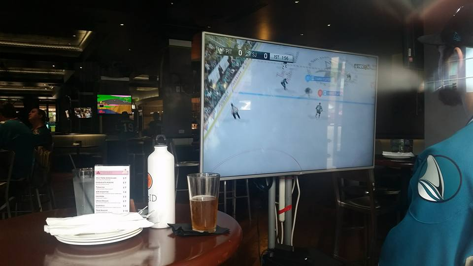 Fans inside AFAK Gamer Lounge playing as the Sharks vs. Pens (setup in the main window facing the street)