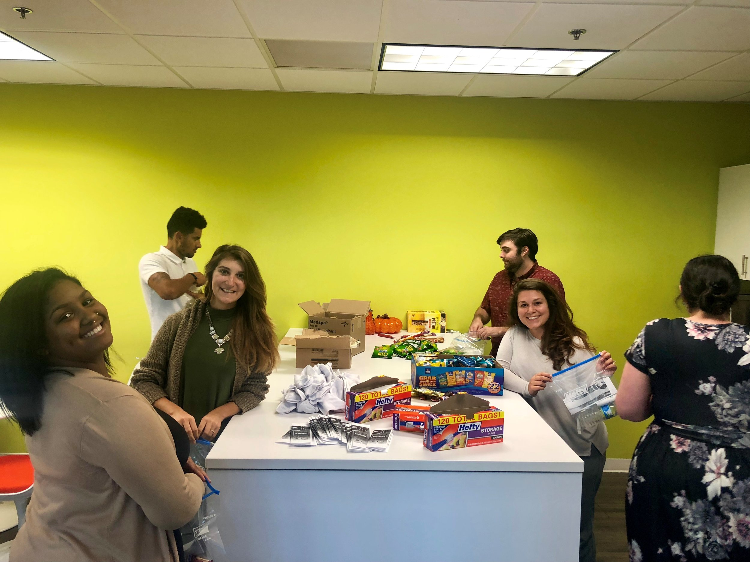 A few of our wonderful team members, Julien, Katey, Raquel, Ty, Caci, and Ariel worked together to assemble Love Bags for our community! Awesome job, Platinum Family!