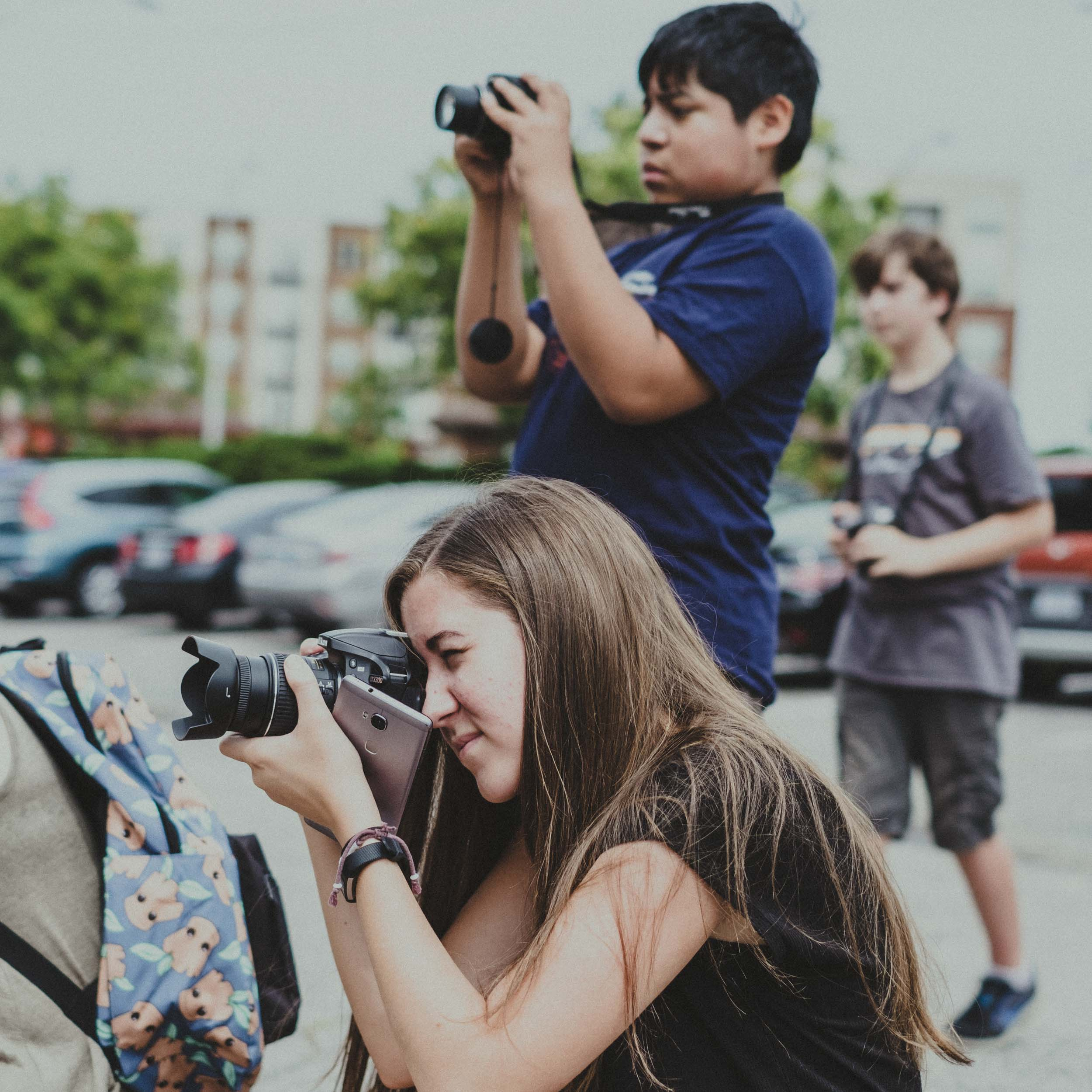 Campers learning about the rule of thirds using urban architecture
