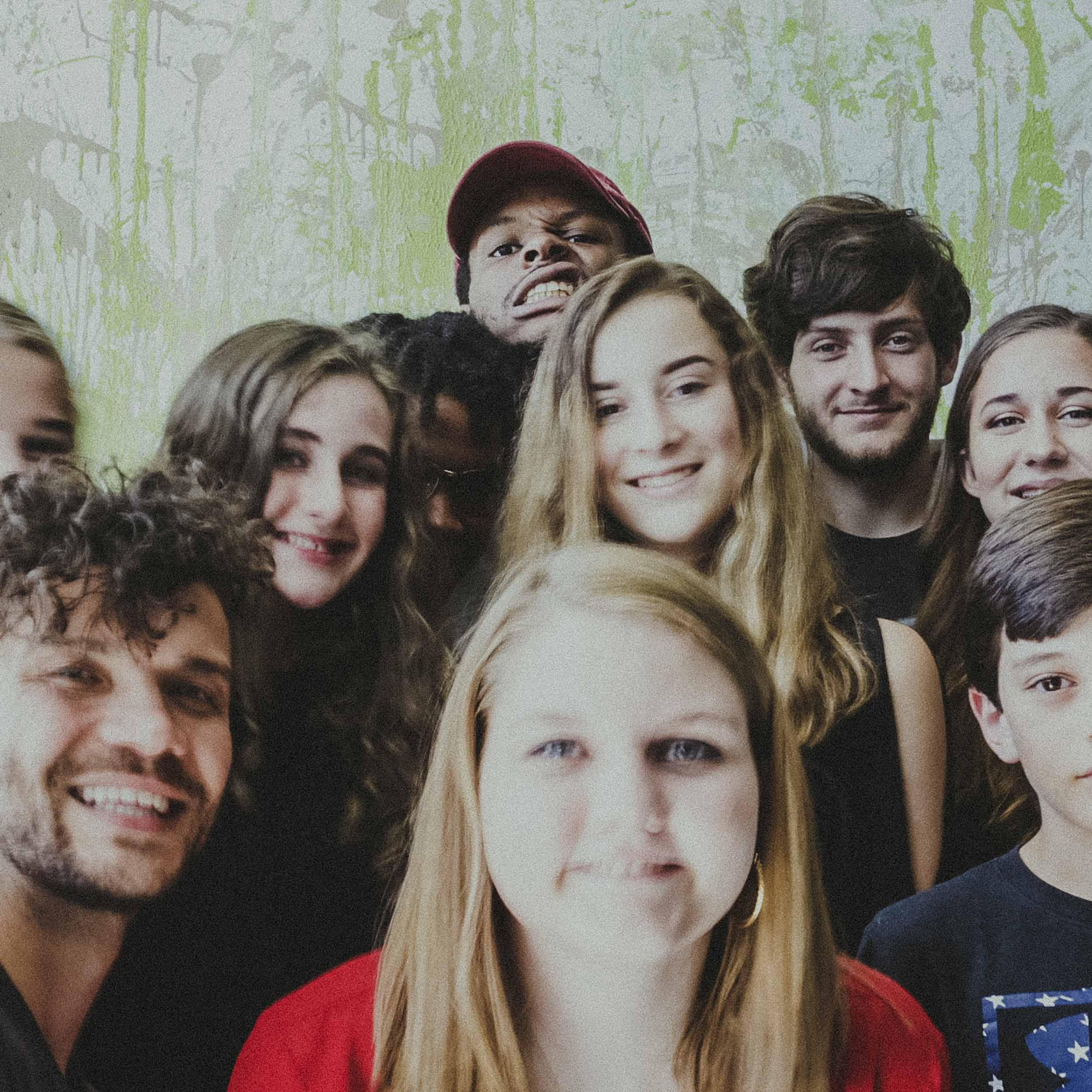 A group photo of campers after a shoot with Durham rapper, Defacto Thezpian
