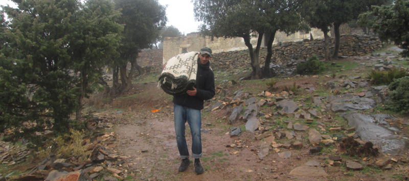 One of our friends helping to carry an old carpet down the side of the mountain in the Middle Atlas