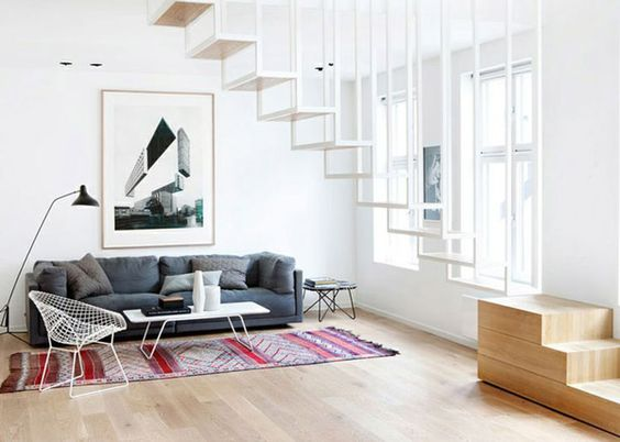 A Zaiane kilim used in a modern Oslo apartment with floating steel staircase. Photo from Design Hunter
