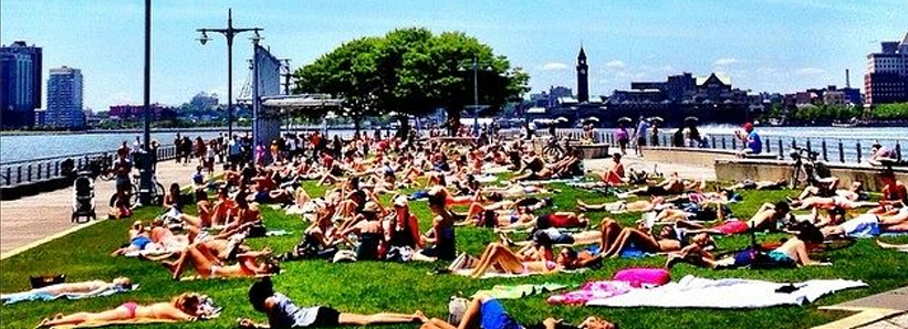 Sunbathers at Pier 45 on a sunny weekend afternoon.