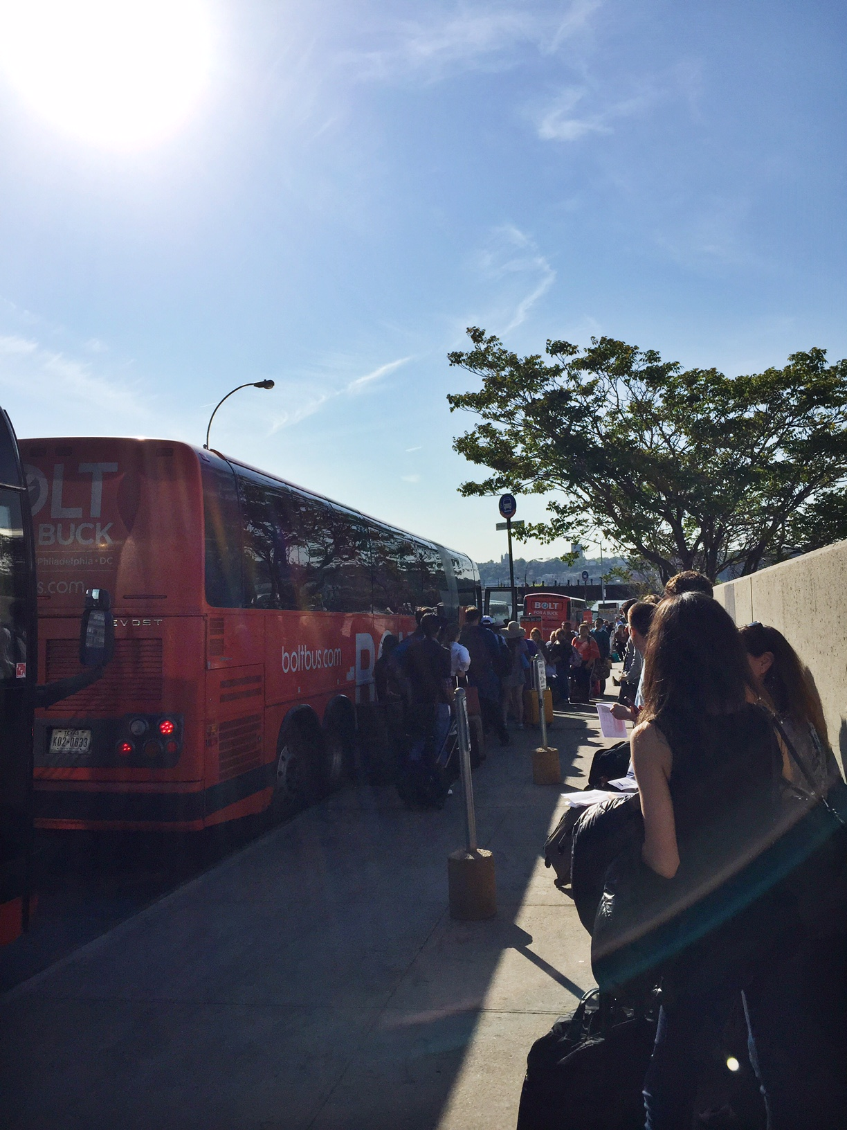 The busses and passengers stretched for over threeblocks.