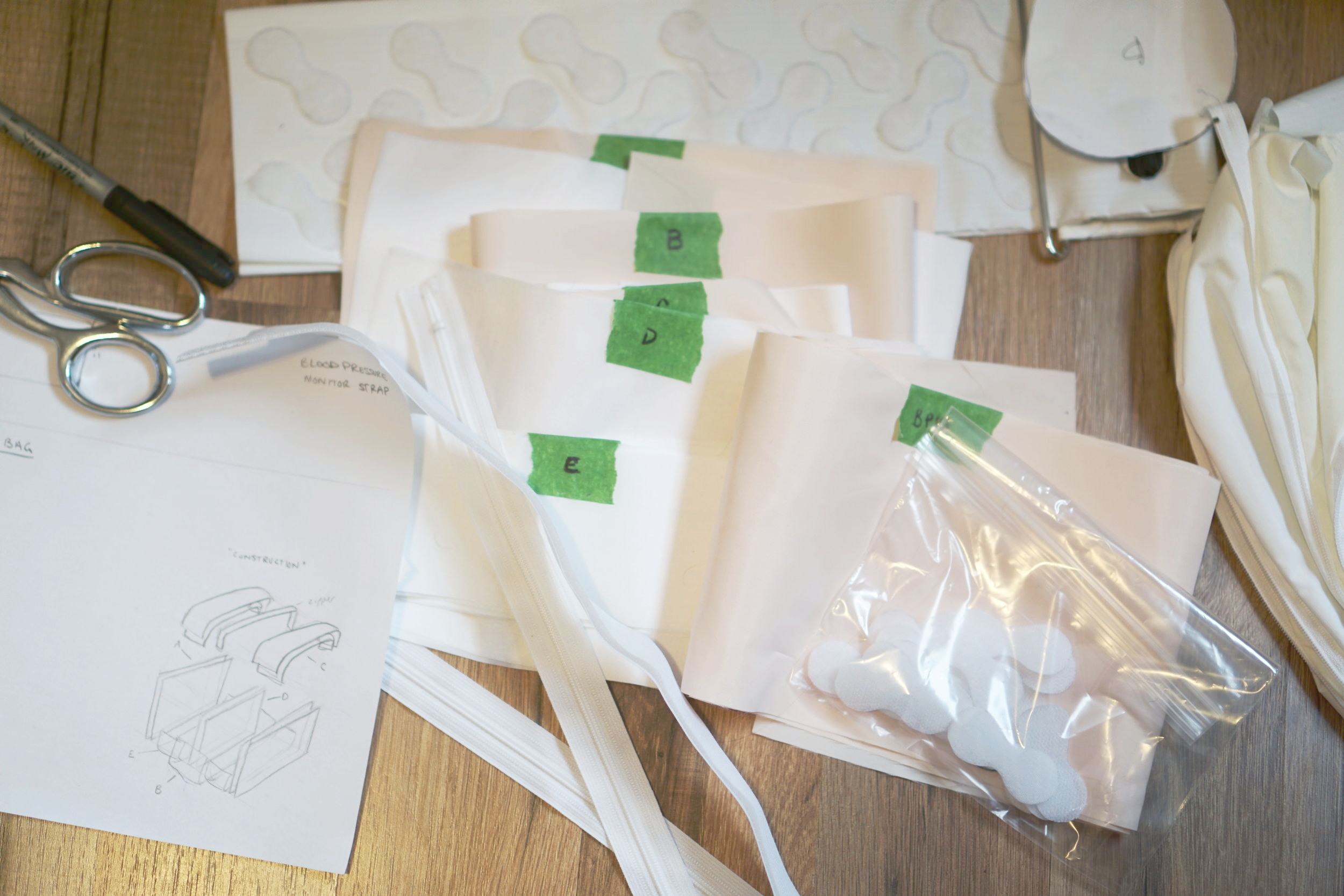 Construction plans and components being organized for the production of the bag soft prototype.