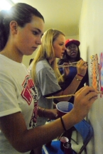 JLL Volunteers painting at West Harlem Group Assistance.