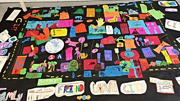"""The completed community mural from the Saturday """"Art Around the World"""" program at Inwood Public Library."""