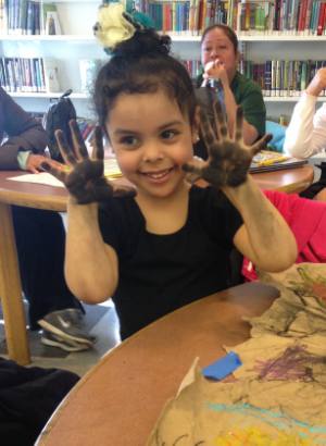 Art is messy. Making hand prints at Inwood Public Library.