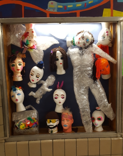 Display of student work from Lost and Found Sculpture in Hallway