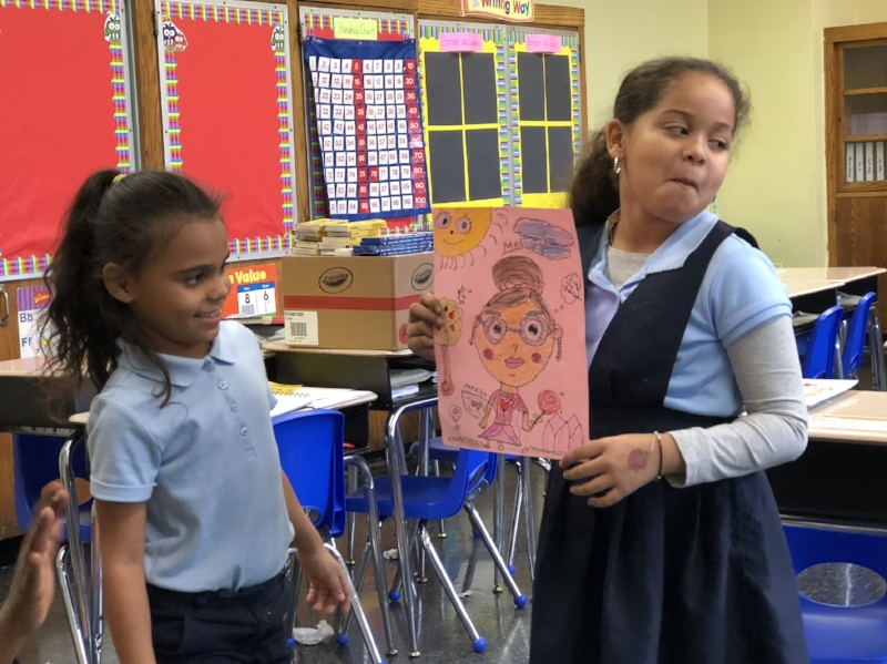 A second-grade student at PS 192 shares her self-portrait.