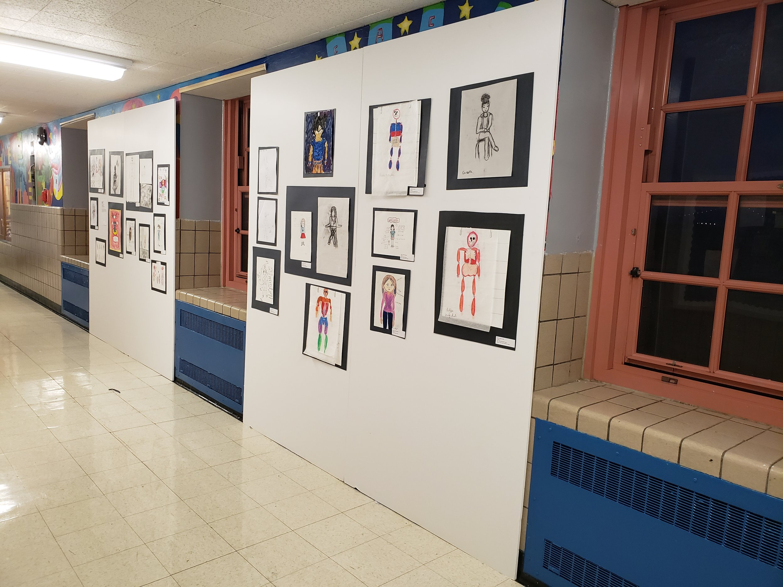 Working under a tight deadline, students in the Cartooning and Anatomy program at HGMS installed the hallway displays for their own culminating event. Working in small teams, they curated the drawings and treated the art with the same care and respect they would give their own submissions.