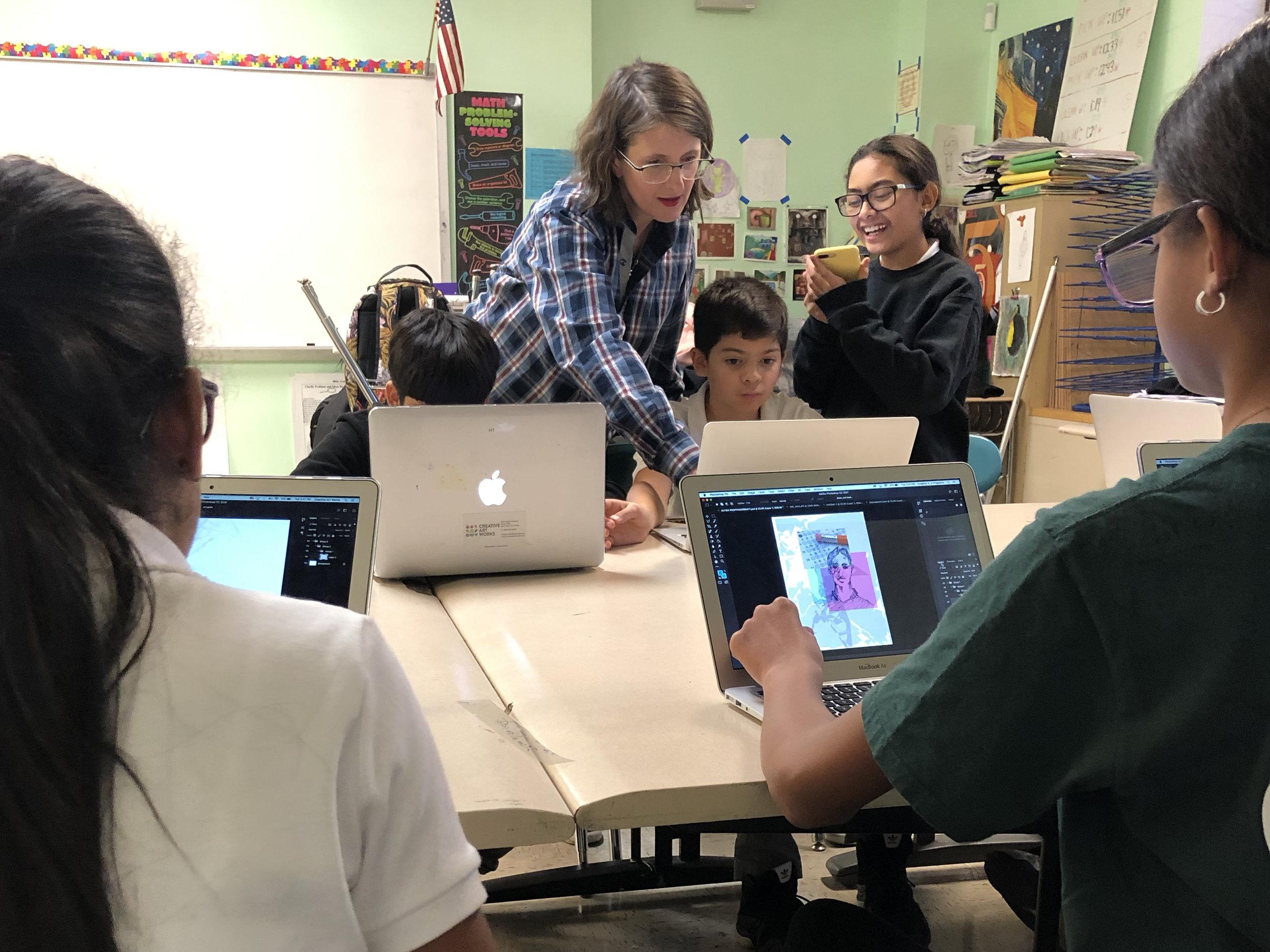 Teaching Artist Brandi Martin Yu with students in the Digital Arts program at PSMS 278.