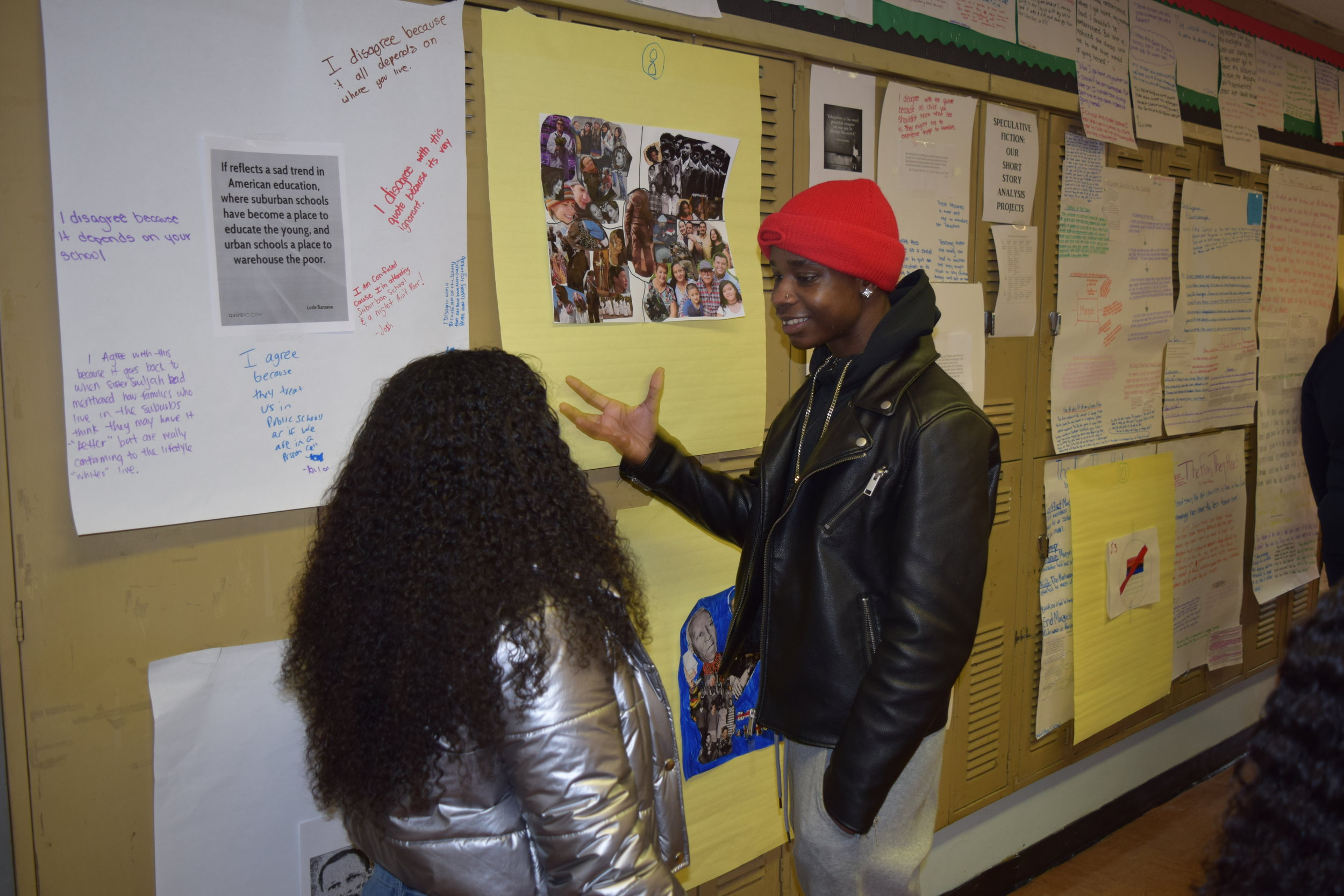 Students in a Social Justice Class discuss a collage about racism by one of their peers.