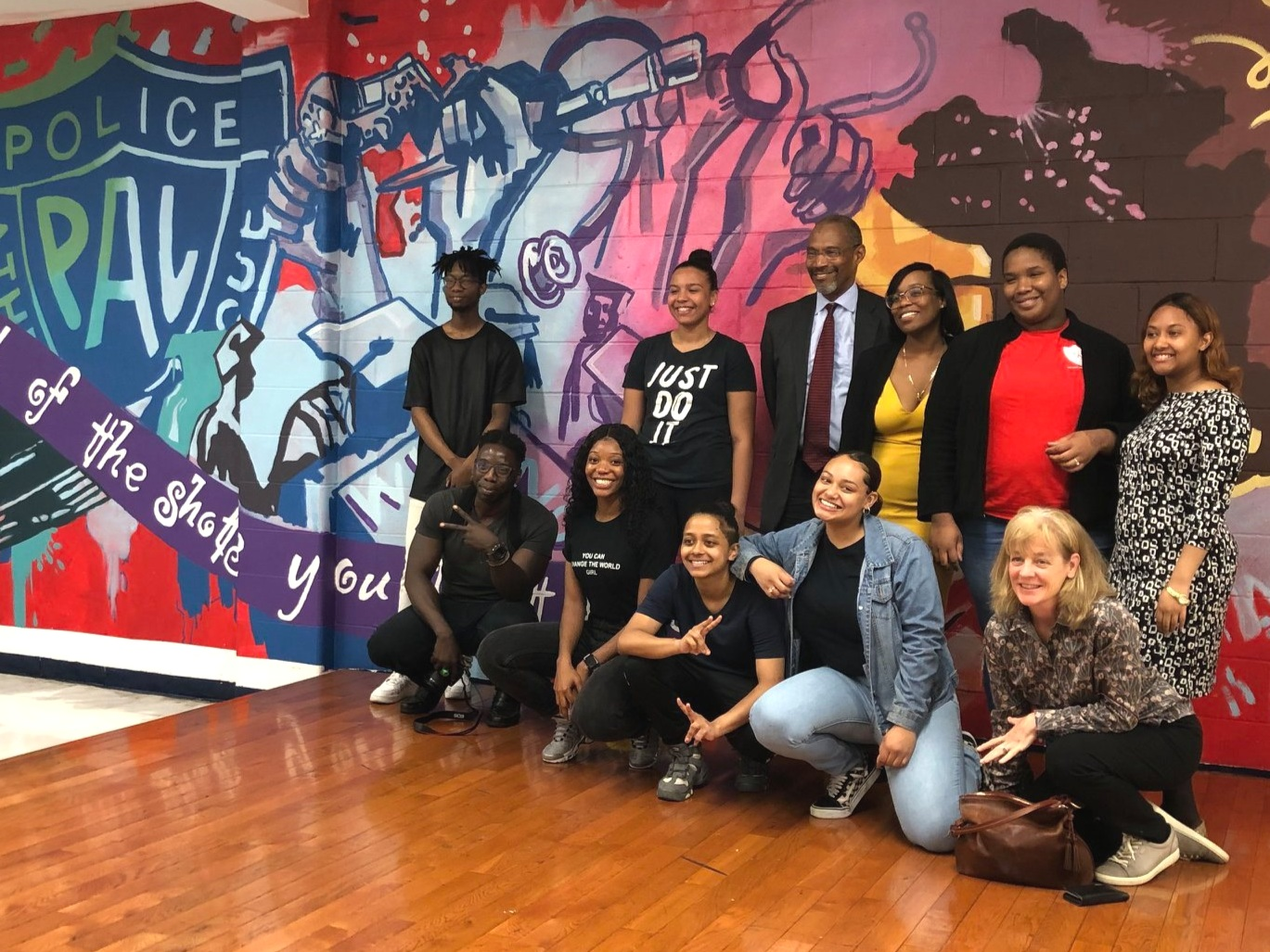 PAL Executive Director and founder of the College Access program    Fred Watts    (back row center) at the unveiling of the new mural