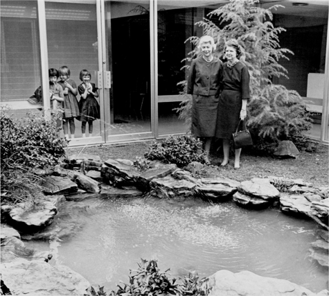 Mrs. John Cobbs, left, and Mrs. Parker Evans at the Children's Hospital garden    Throughout our history, Little Garden Club members have planted public spaces and contributed to the wildlife preservation in our community. In the mid 1960s we developed a program to educate children about trees native to our area. During the centennial of Birmingham and in a joint venture with Red Mountain Garden Club, members landscaped the Village Promenade in Mountain Brook. A circle of islands was planted with shrubs; walkways and a permanent Christmas tree were installed. The LGC established a wildflower trail at Samford University and worked with local Boy Scouts to place bluebird houses in several locations around the city. This conservation endeavor helped to reestablish thebluebird population, which had been waning due to lack of proper nesting places.