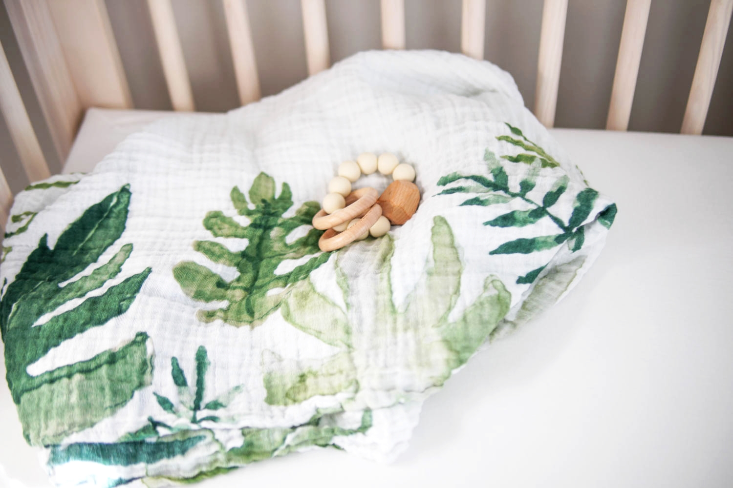 Pictured above:   Little Unicorn Tropical Swaddle  //  Chewable Charms