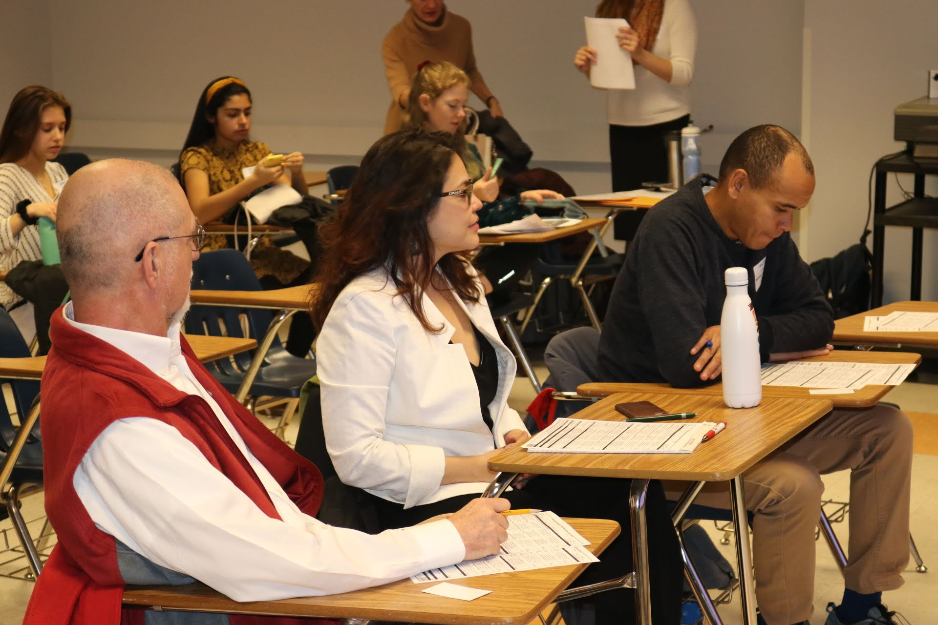Judges attentively observing the students' presentations and offering constructively feedback.