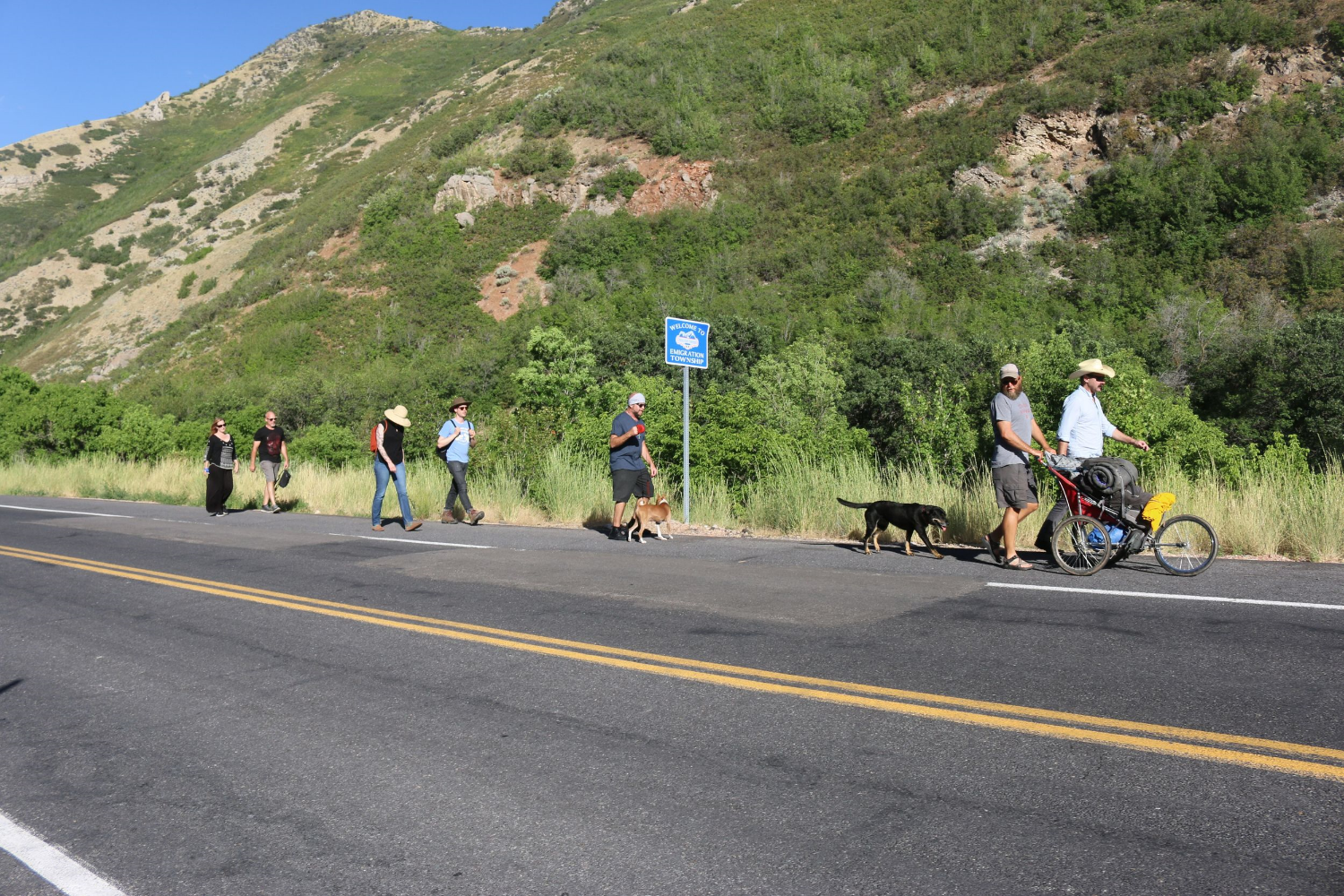 Artist,Adam Bateman walking the final six miles with friendsfrom Immigration Canyon to downtown Salt Lake on July 11, 2015.