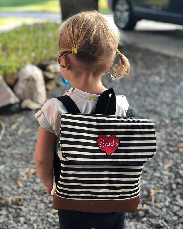 New daycare, new backpack (+ patch to honor the key to her heart), old paci🙄