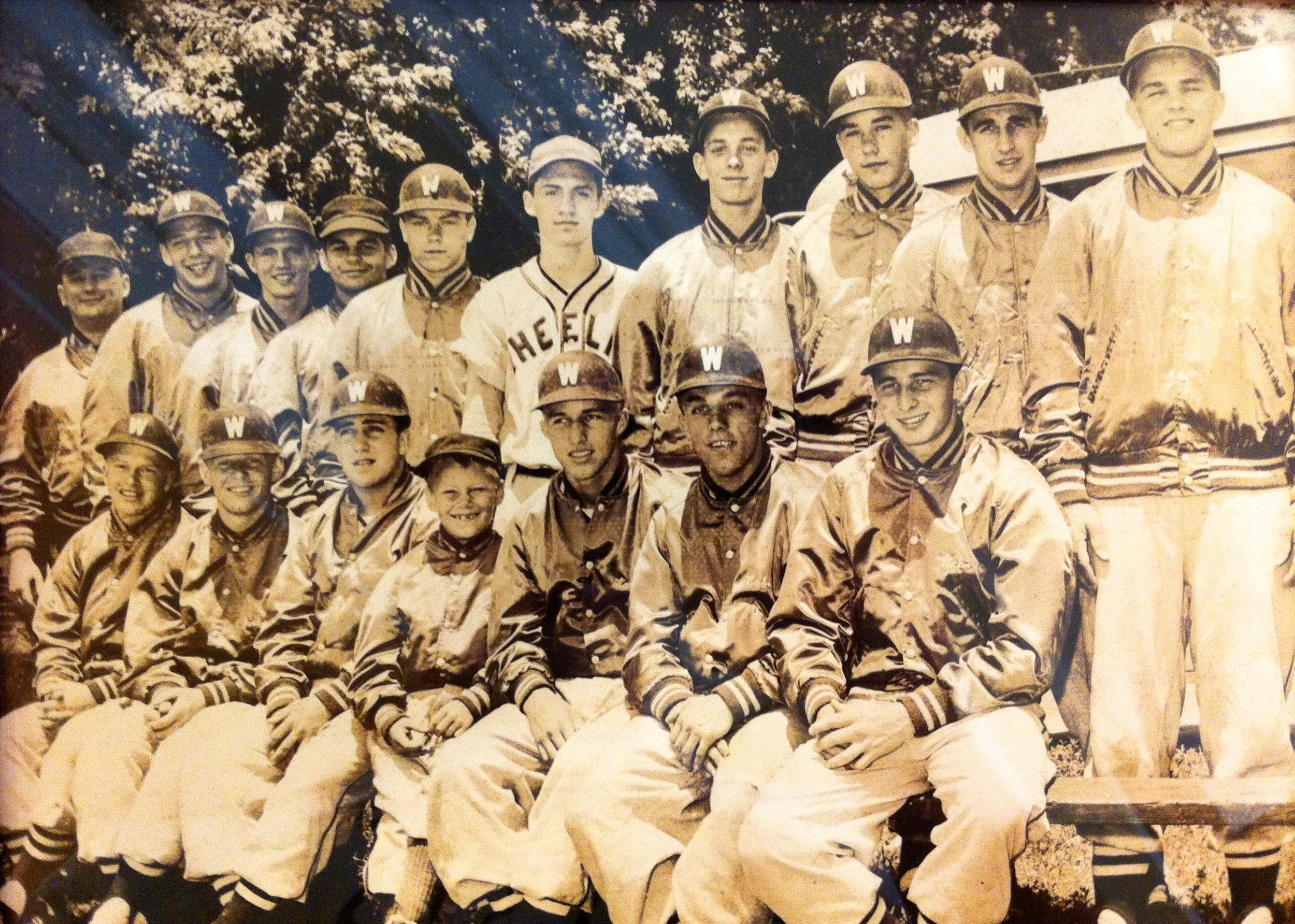 Seated L-R: Leo Hollein (Linsly), Joel Armentrout (Warwood), Tom Seamon (Triadelphia), David Zarnoch (Bat Boy), Larry Walters (Triad.), Bob Flading (Wheeling Central), Rich Green (Warwood)  Standing L-R: Tipper Zarnoch, Bob Weiss (Triad.), Frank Paczewski (Whg.), Larry Wells (Linsly), Don Milligan (Triad.), Frank Auth (Linsly), Bob Peyton (Triad.), Don Mullarkey (Triad.), Don Tennant (Whg.), Joe Maestle (Wheeling Central)