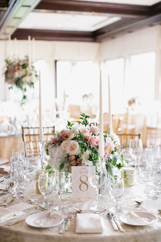 Here we've removed the charger, but upgraded the linen, added a mirror to the center, along with candles. Again, the same estimates apply. Anywhere from $150-$250 per table - inclusive of linen, florals and elements.
