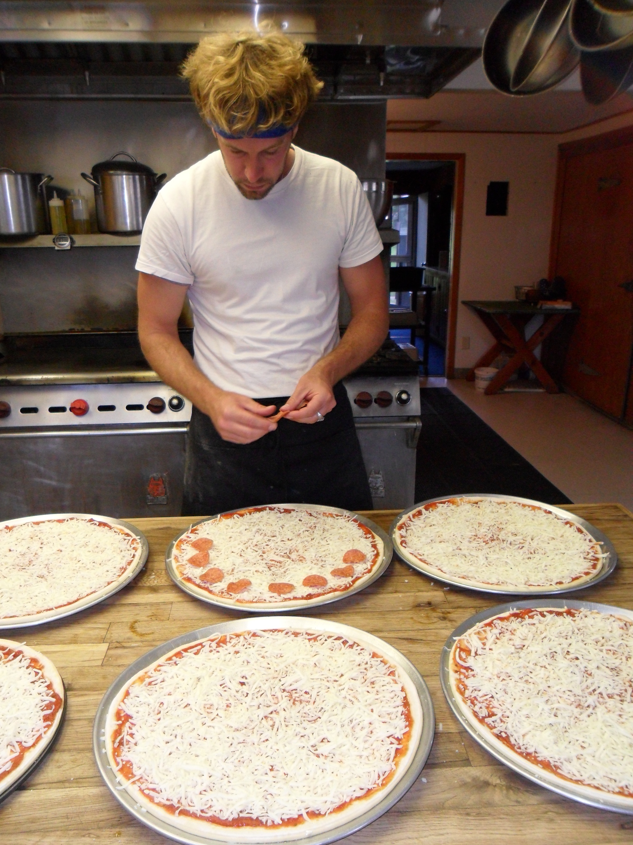 Making pizzas for The City Kids Wilderness Project in Wyoming with locally made Bison pepperoni and Elk sausage.