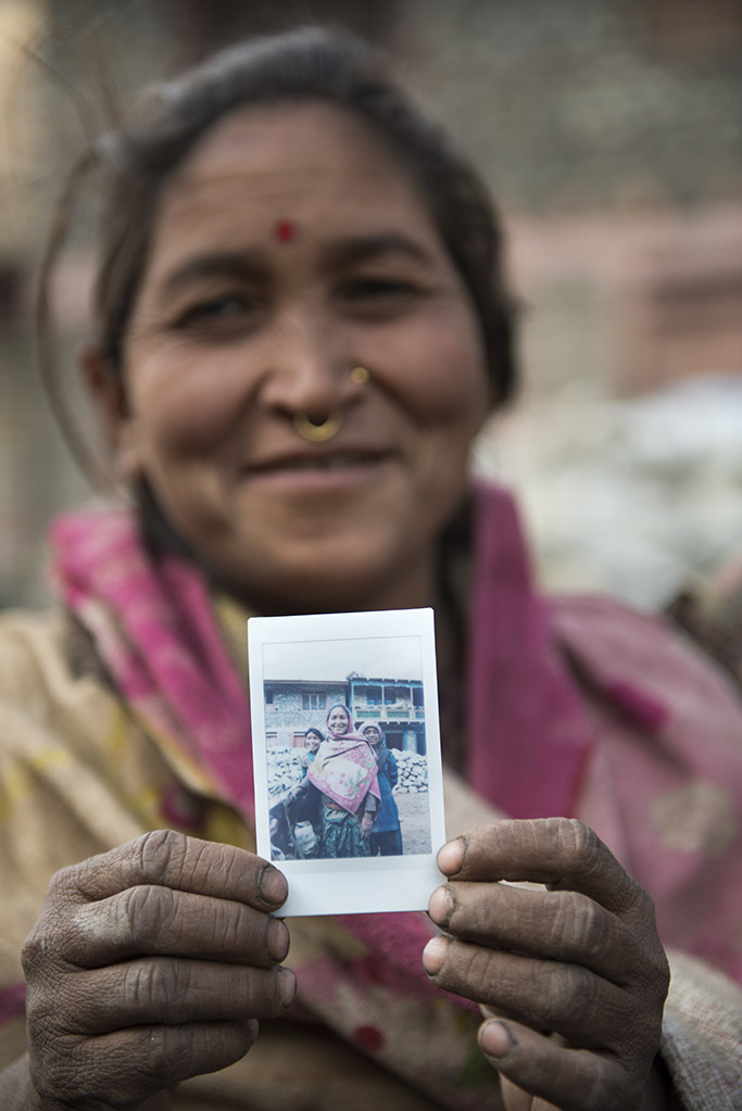photos of people holding an instax photo