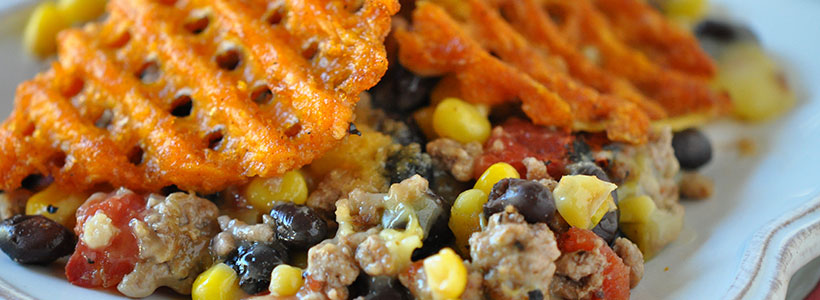 SOUTHWESTERN BEEF CASSEROLE WITH SWEET POTATO WAFFLE FRIES TOPPING