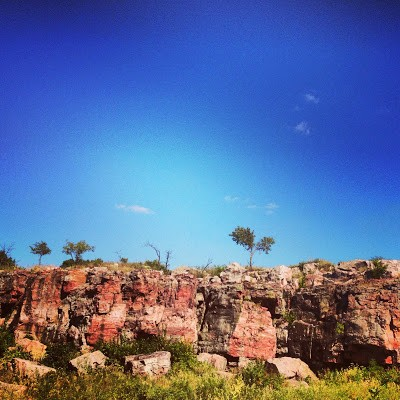 The distinctive red Sioux Quartzite cliffs of Pipestone National Monument.