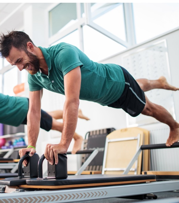 two-young-men-having-a-pilates-class-at-health-club-picture-id495506158.jpg