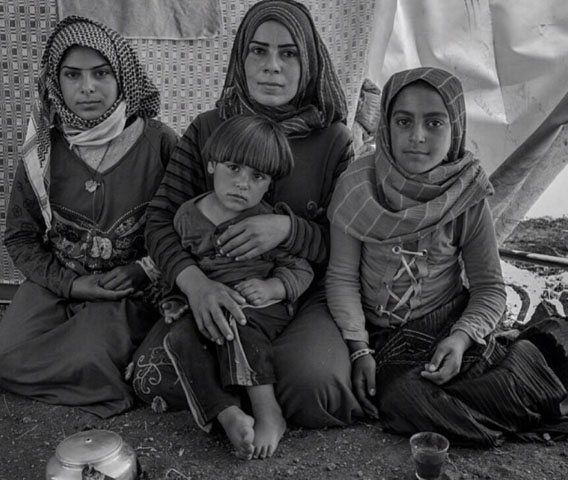 Displaced family in Syria Photo by Peter Biro (Circle of Health).jpg