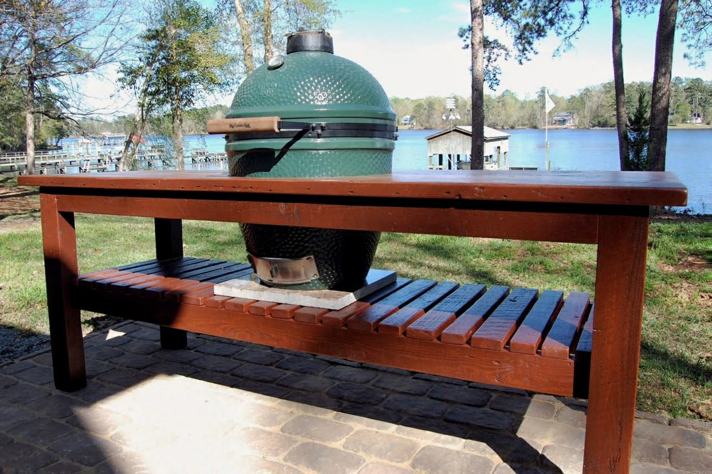 Custom table built to fit a Big Green Egg. Stained in Heritage Red and coasted with a weather resistant marine varnish.