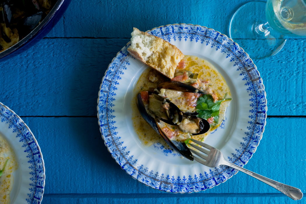 The best to eat the mussels is with crusty warm bread that you could dunk in the cream sauce.