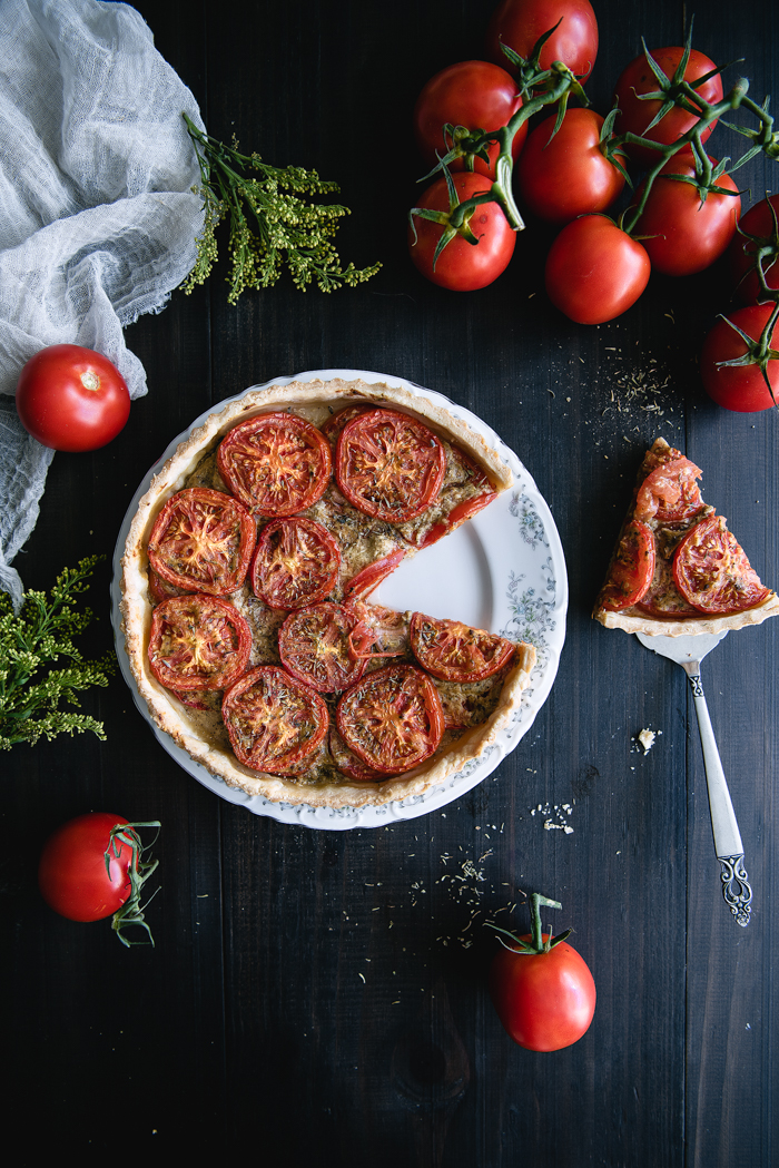 Tomato & Mustard Tart - Pie crustUnbleached all purpose flour – 3 cupsRaw sugar – 2 TBSPFine sea salt – 2 ½ TspUnsalted butter, chilled and cut in pieces (see notes) – 2 sticksFull fat organic coconut milk – ⅓ coconut milkIced water – About 1/2 cupTomato and mustard fillingBeefsteak tomatoes – 6 to 8 tomatoesBasil mustard (or regular Dijon mustard with some fresh chopped basil) – 3 TBSPGrainy mustard – ½ TBSPGround dried ginger – ¼ TspHerbes de Provence – 1 TspGround sage – ¼ TspGround garlic – ¼ Tsp (see notes)Extra virgin olive oil – 1 TBSPAsiago Cheese, grated – 1 ½ TBSP, dividedFine sea salt – 1 Tsp + 2 pinchesUnbleached all purpose flour – 2 TspShallots, diced – ¼ cup