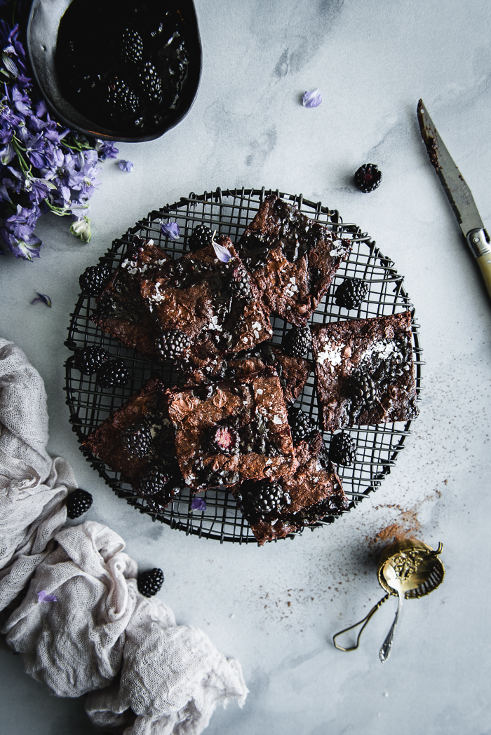 Brown Sugar Blackberry Brownies - Unsalted butter, chopped in pieces – 1 stickDark brown sugar – 1 cupSemi-sweet chocolate chips – 12 oz (one bag of chocolate chips) + 1 cupCocoa powder – ¼ cupUnbleached all purpose flour – ½ cupVanilla extract – 1 TspFine sea salt – ½ TspWhole eggs – 3Egg yolk – 1Blackberry marmalade or preserves – 2 to 3 TBSPSea salt flakes to sprinkle on top (optional)