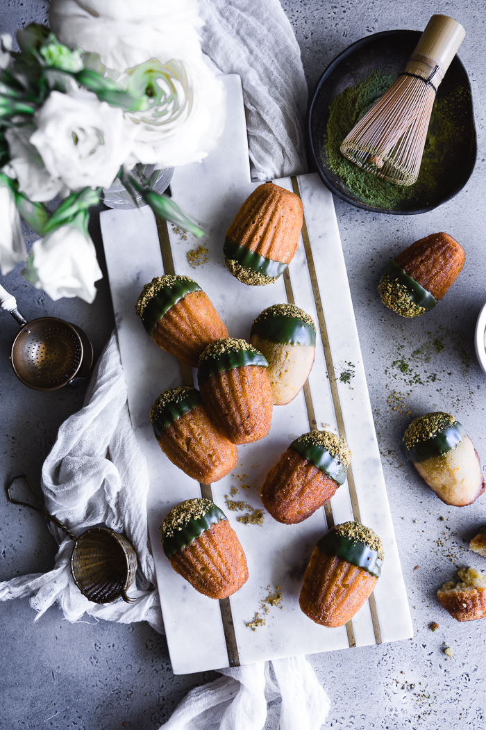 Mint Matcha Madeleines - Madeleine CakesOrganic grass feed unsalted butter – ½ cup (1 stick) + 2 TBSP for the panOrganic free range eggs, at room temperature – 2Raw sugar – ½ cupOrange or lemon zest – 2 TspPure vanilla extract – 1 TspMint extract – 1 TspUnbleached all purpose flour, sifted – 1 cupBaking powder – ½ TspFine sea salt - ⅛ TspMatcha GlazeConfectioner's sugar, sifted – 1 cupMatcha powder – 1 TBSPAlmond milk or water – 1 to 2 TBSP, depending on consistencyPinch of salt