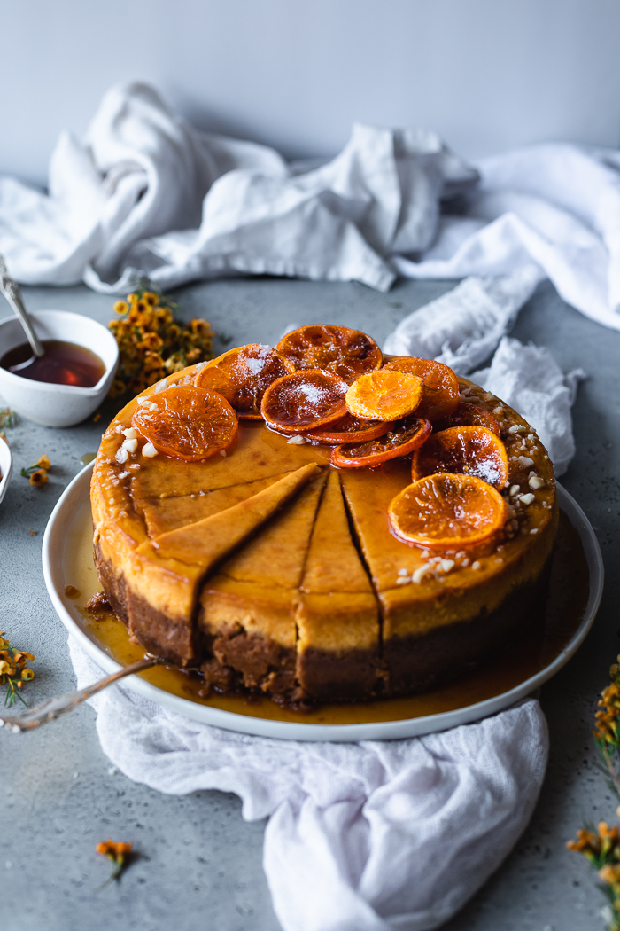 Pumpkin Cheesecake with grated ginger, candied oranges and caramel sauce