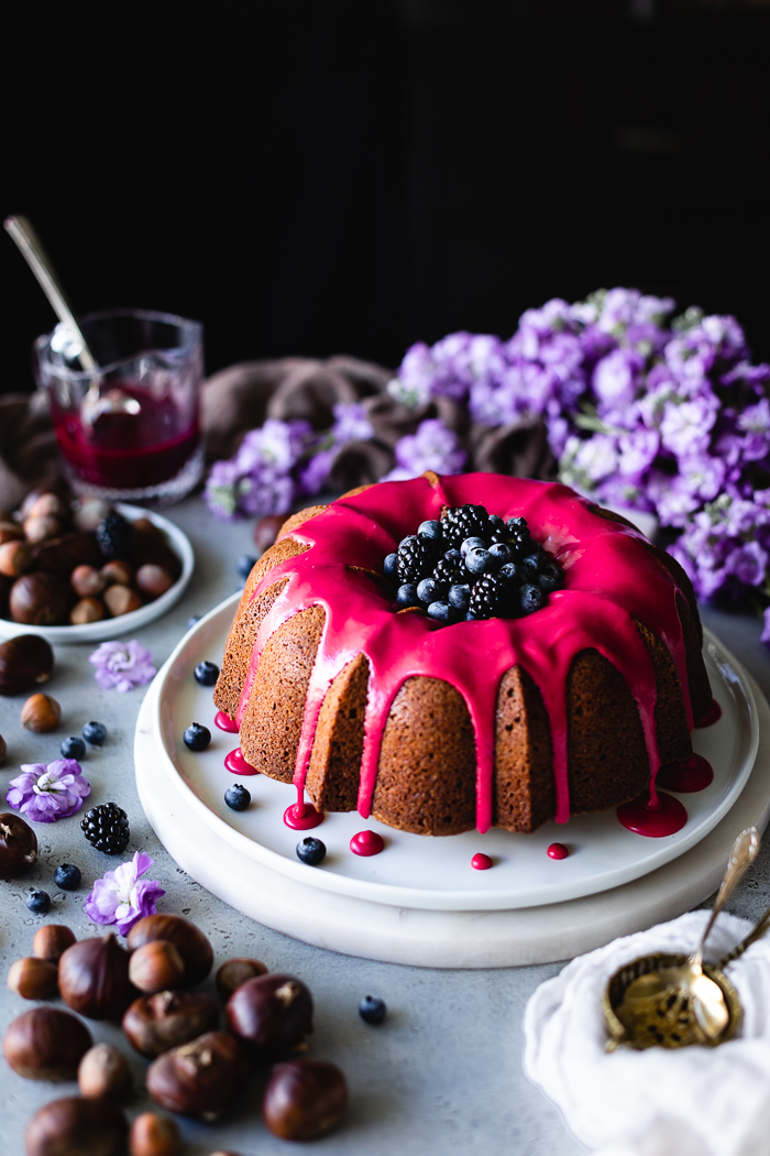 Roasted Chestnuts Bundt Cake - Cake:Unbleached all purpose flour – 2 ½ cupBaking powder – 2 TspRoasted chestnuts, roughly chopped – about 1 cupEggs, large – 4Raw sugar – 2 cupsVanilla extract – ¼ TspFine sea salt – ½ TspFull fat coconut milk – ½ cupCoconut oil – 1 cupRoughly chopped hazelnuts – about 1 cupBlackberry Glaze:Blackberries – 1 cupRaw sugar – 4 TBSPLemon juice – 1 TBSPPowdered sugar, sifted – 2 cups