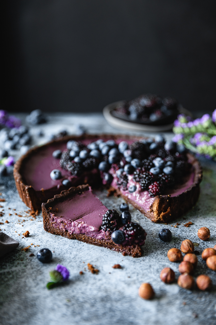 Blackberry Blueberry Tart with Almond Dark Chocolate Crust - Pâte SabléeButter, at room temperature – 8 TBSP (1 stick)Powdered sugar – ½ cupLarge egg yolk – 1Fine sea salt – ½ TspPure vanilla extract – 1 TspFinely crushed hazelnuts (see notes) – ¼ cupDark or regular unsweetened cocoa powder – 3 TBSPUnbleached all purpose flour- 1 1/4 cupCoconut or any other milk of choice – 2 TBSP, as neededBlackberry Blueberry FillingA mix of blackberries and blueberries – 3 ½ cupsRaw sugar – 2 TBSP + ¼ cupFreshly squeezed lemon juice – 2 TBSPCoconut milk – 1⅓ cupPure vanilla extract – ½ TspUnbleached flour – 4 TBSP