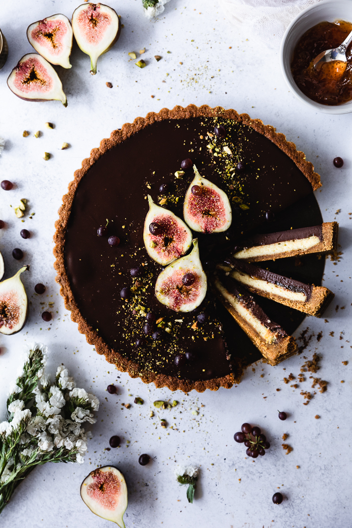 Chocolate & Cheesecake Fig Tart - CrustPistachios – ½ cupTraditional graham crackers – 8 oz (15 whole rectangular cookies), broken in small piecesUnsalted butter – 10 TBSP (1 ¼ stick)Raw sugar – 2 TBSPCheesecake LayerCream cheese – 2 boxesRaw sugar – ¾ cupUnbleached all purpose flour – 1 TBSPFreshly squeezed lemon juice – 1 TBSPVanilla extract – 1 TspOrganic cage free eggs – 2Egg yolk – 1Fig Marmalade and Chocolate Ganache LayerSemi-sweet chocolate chips – 1 ½ cupsCoconut milk – ¾ cupRaw sugar – ½ TBSPVanilla extract – ¼ TspPinch of fine sea saltChopped pistachios to decorate