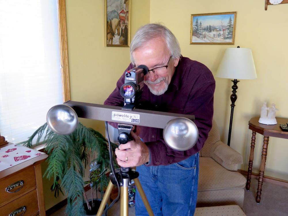 Dalles Schneider with Super8 Canon 310XL film camera & lighting rack