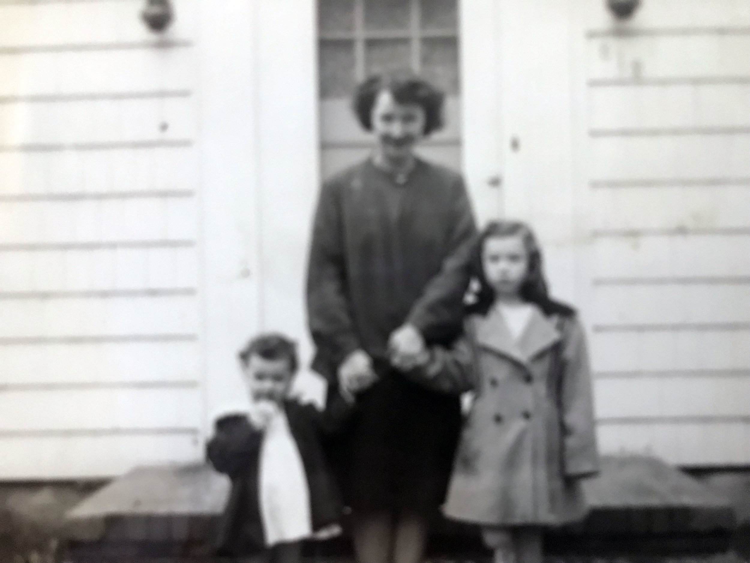 Harriet Englert with children Ann and Darlene stand in front of first family residence (image copyright, W.L. and D.K. Talbott Trust)