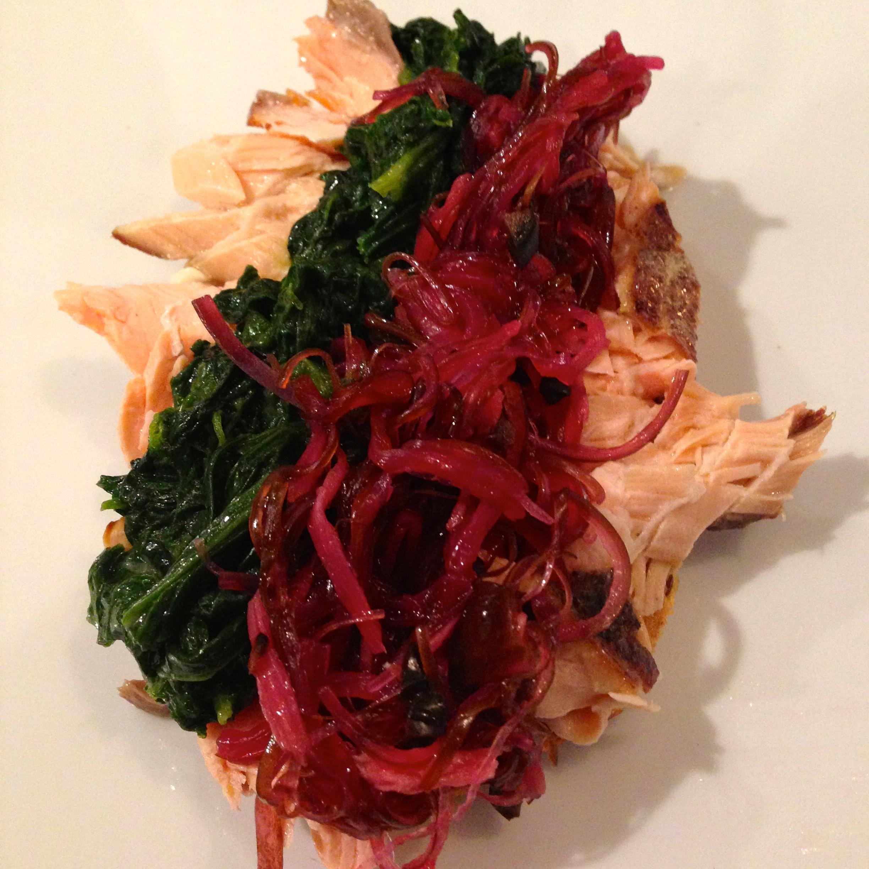 Smørrebrød with smoked salmon, greens, and onions