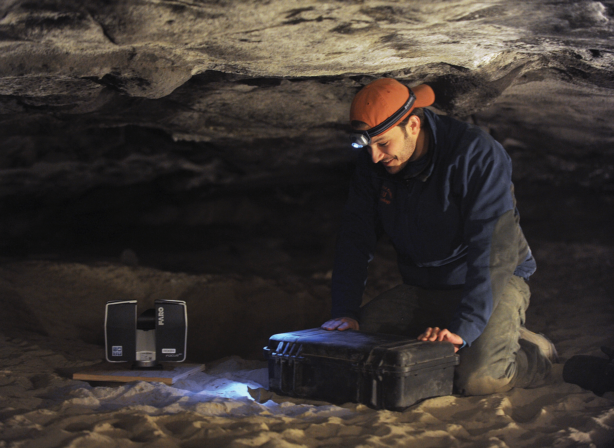 Nicholas Holmer, research associate for Idaho Virtualization Laboratory, sets up the FARO Focus 3-D Lidar Scanner Feb. 27 at the dump sight of a cold case murder from 1979 in Dubois. With the scanner, Holmer will be able to make a 3-D map of the cave with millimeter accuracy.