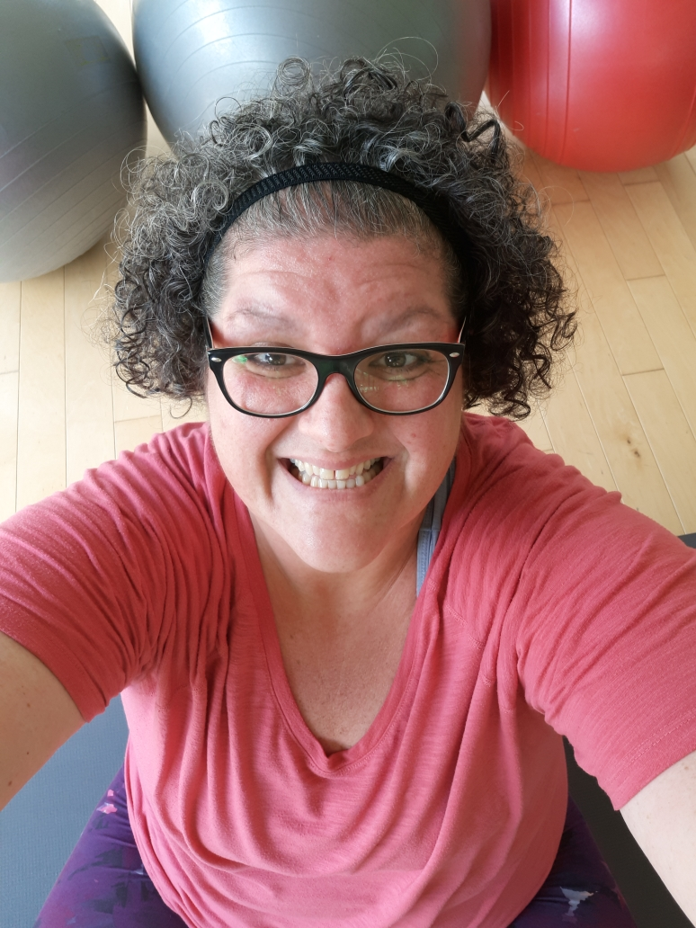 """MICHELE - In 2012 I went to my first yin yoga class. I was SO worried that I would not be able to do anything because my body was sore, my muscles were stiff, my joints hurt, I was physically """"out of shape,"""" I was depressed and I was anxious. I was feeling bad about myself and I no longer wanted to feel this way. After my first yin class I felt different, in a way I had never felt before. I felt relaxed physically and mentally and I knew then that this was something that was going to help me feel better all around. I was so stunned by how great I felt that I knew I needed to pursue """"this yoga thing"""" further for my own physical, mental and energetic health."""