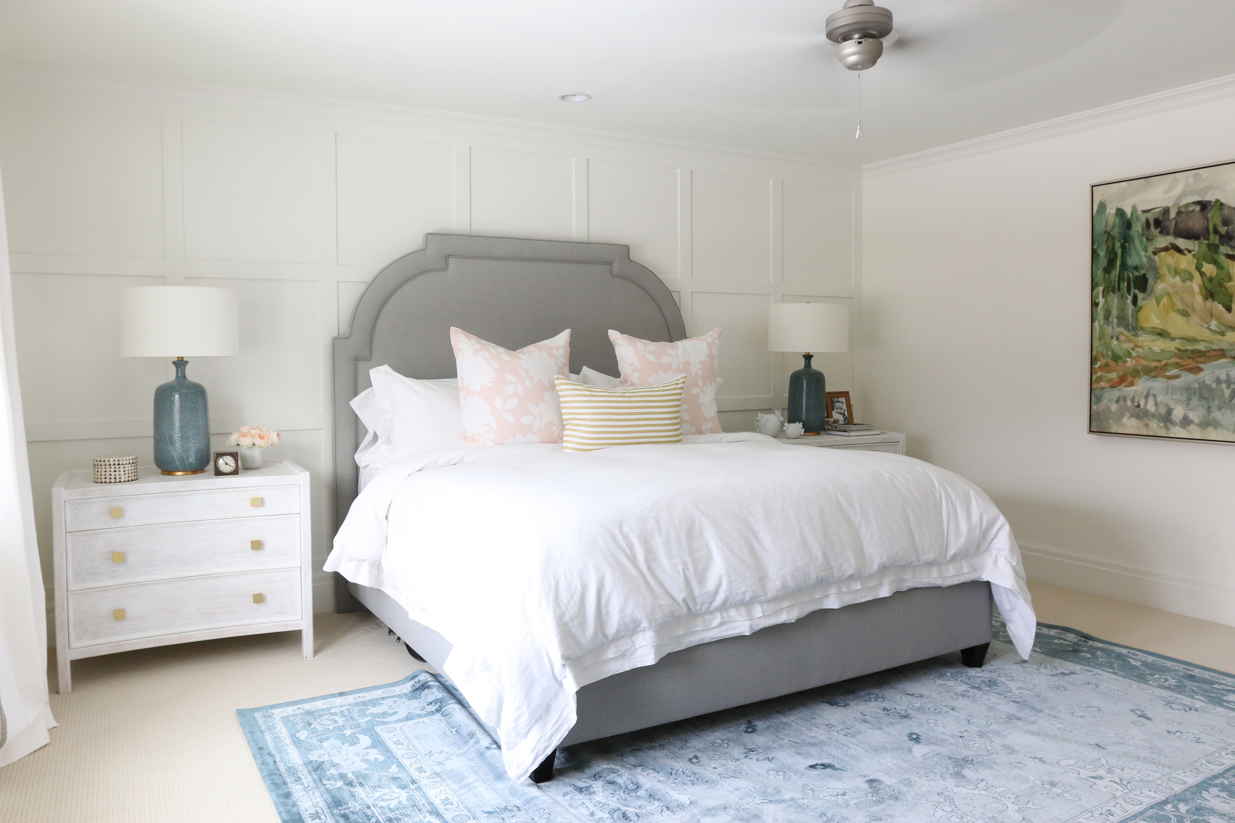 Gray Headboard, overdyed blue rug and abstract art || Studio McGee