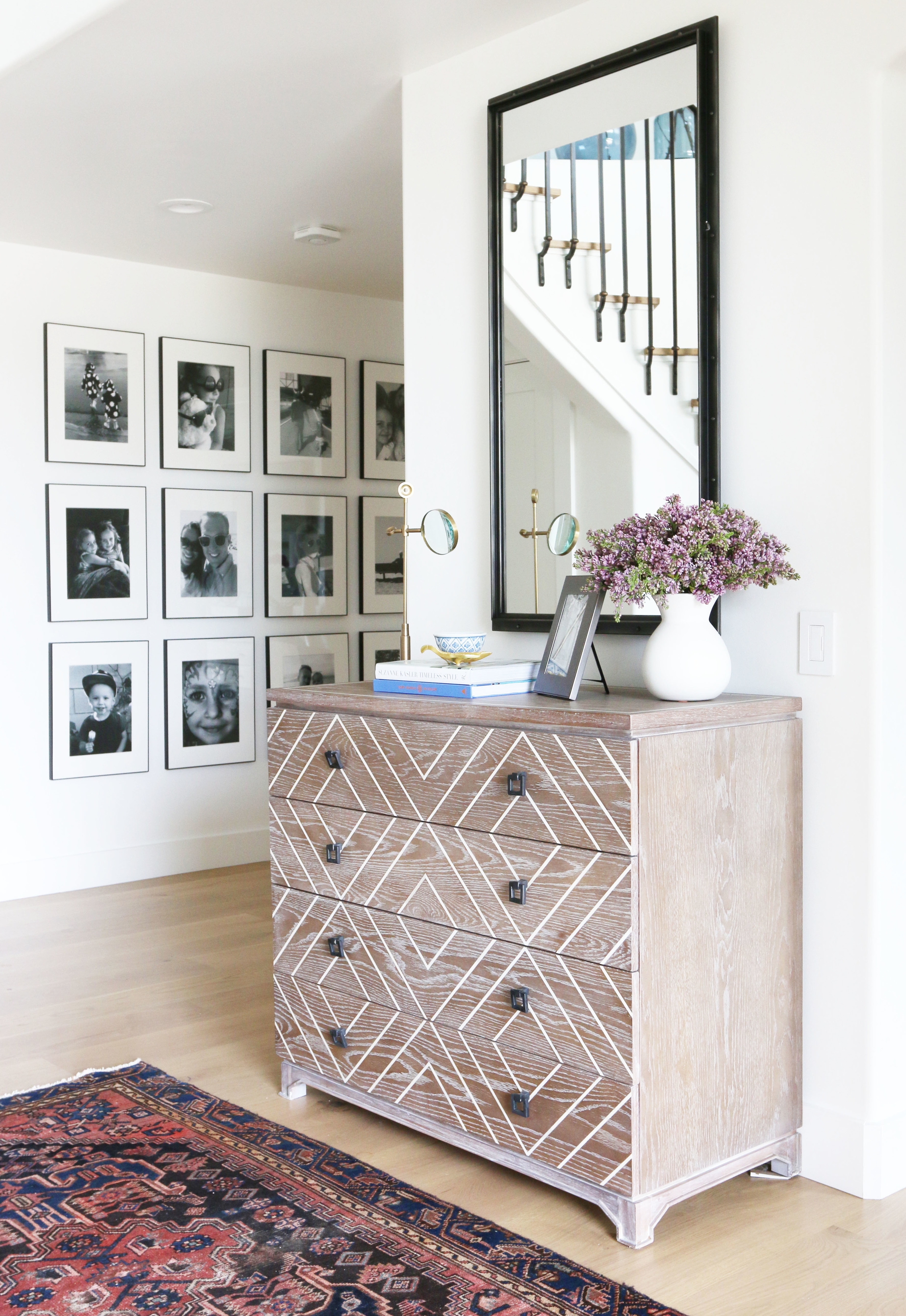 Persian rug and gallery wall in the entry || Studio McGee
