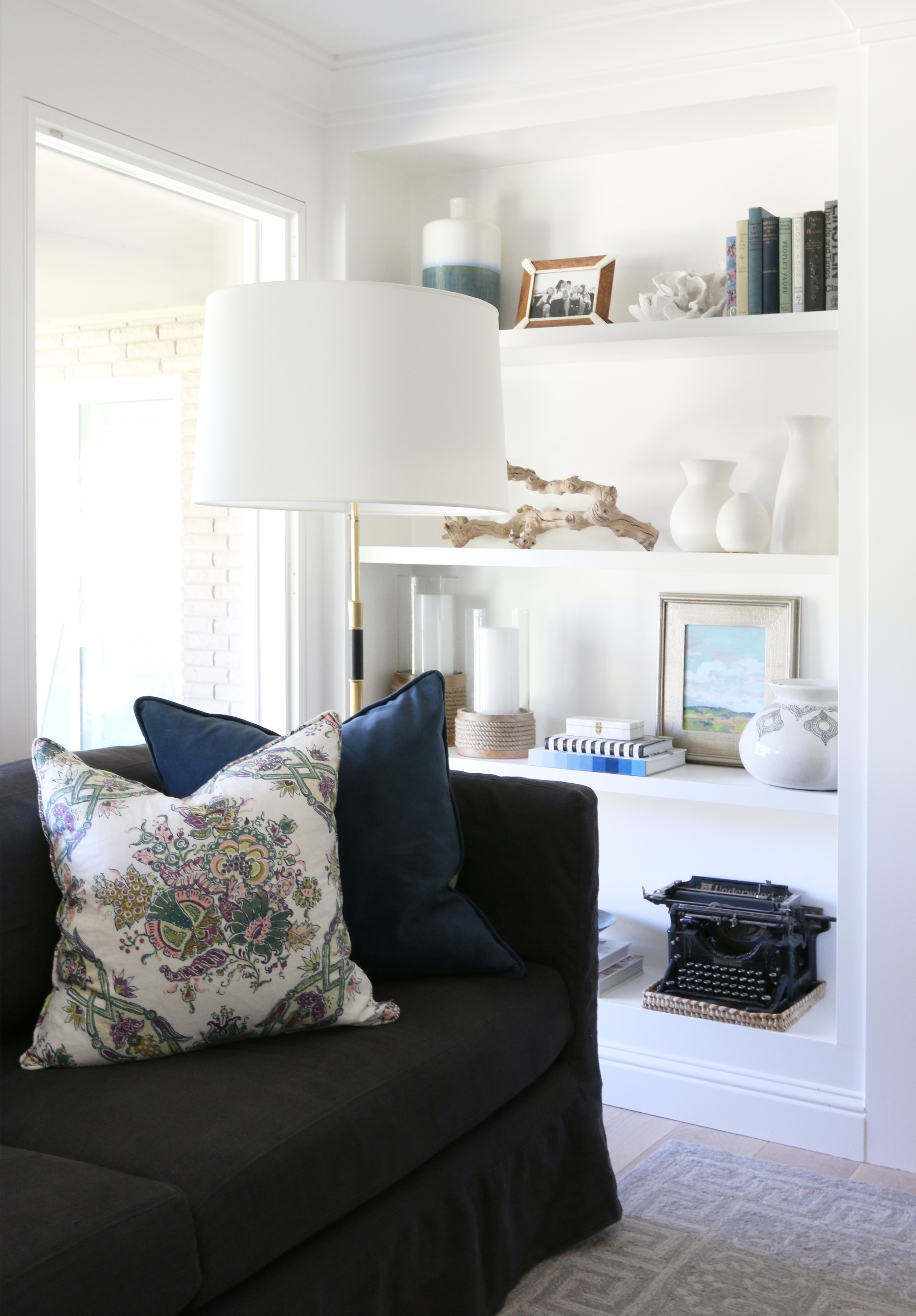 Charcoal sofa and built-in shelves || Studio McGee